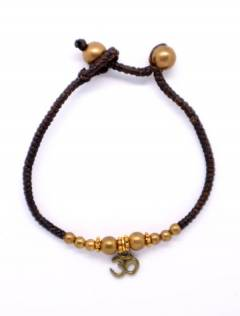 Macrame and brass bracelet with OM pendant PUAM07-D to buy in bulk or in detail in the Alternative Ethnic Hippie Jewelery category.