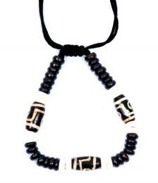 Bracciale etnico con perle di osso. Bracciale realizzato da artigiani tibetani PUHU22 per acquistare all'ingrosso o dettaglio nella categoria di gioielli Hippie etnici alternativi.