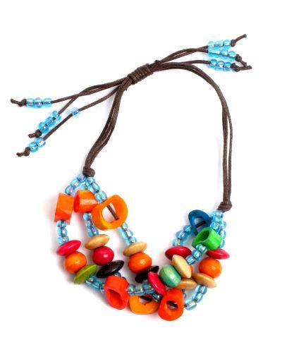 Pulsera hippie hecha a mano con cuentas de hueso, beads de plástico y bolitas de madera coloreadas, cierre regulable - Turquesa Comprar al mayor o detalle