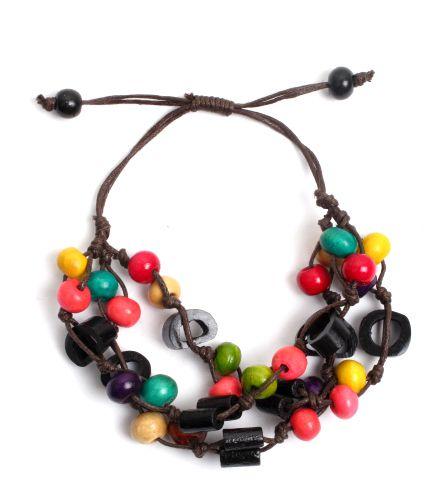 Pulsera hippie hecha a mano con cuentas de hueso y bolas de madera coloreadas, cierre regulable [PUFA03] para comprar al por Mayor o Detalle en la categoría de Pulseras Hippie Etnicas