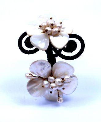 Pulsera semi-rígida con flores de piedras y nacar, para la muñeca Comprar - Venta Mayorista y detalle