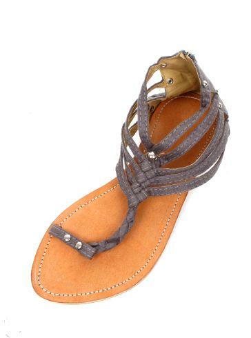 Sandalia dedo, gladiator de material con remaches y cremallera en talón, planta de piel, suela sintética. - detalle Comprar al mayor o detalle